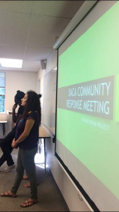 Event organizers speak at the community response meeting. Photo courtesy of Catalina Corvalan.