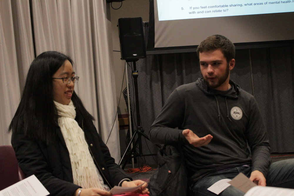 "Senior Angie Peng and sophomore Tucker Wilson discuss the side effects of Whitworth's ""Hello-Walk Mentality."" Photo by Ian Busik."