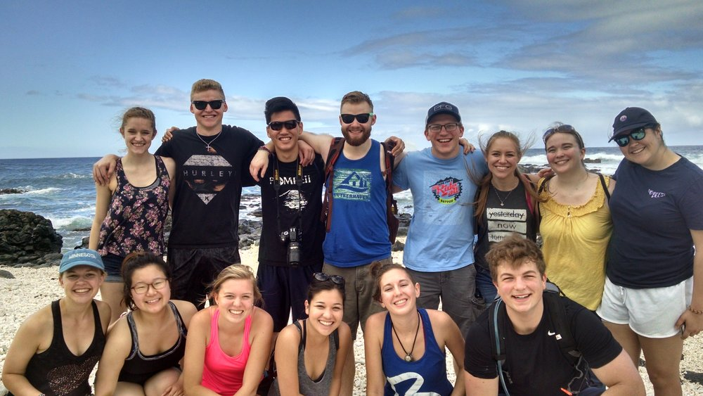 Photo courtesy of Ron Pyle  The interpersonal communications students pose after their hike to the western-most tip of O'ahu, Ka'ena Point. Top row (left to right): Kiana Pieli, Jacob Howe, Justin Li, Andrew Wiebers, Ben Crews, Alyssa Peterson, Jacqui McPeck, Abby Burnett; Bottom row (left to right): Anna Rajala, Erica Sung, Laura Waltar, Sarah Sugano, Madi Binyon, Kaeden Schmidt
