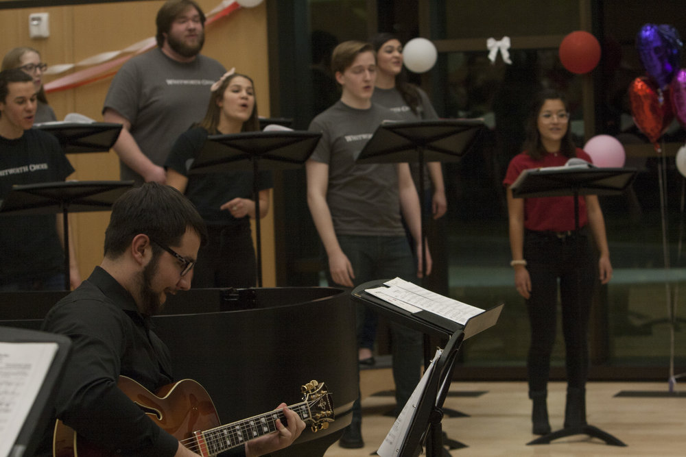 Both the Whitworth and Women's choirs performed at the concert. Pictured, Whitworth Choir members accompanied by senior music major Denin Koch on guitar.