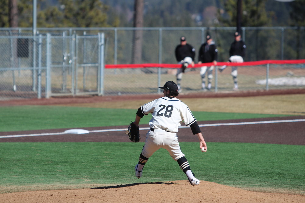 Ian Busik  | Photographer  Senior Brady Simmelink pitching in win against George Fox on March 10.