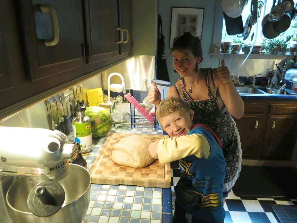 Caitlin at home baking bread with her stepson