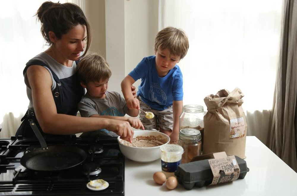 All in: Bec Bowie with her twin sons, Alby and Van, making pancakes at home. Picture: Marina Neil