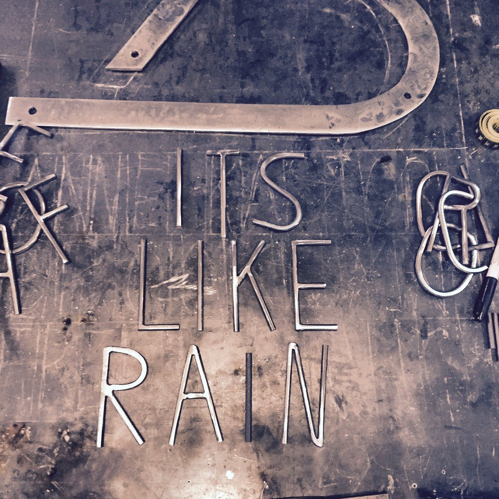 sign its like rain.jpg