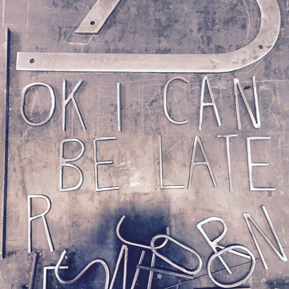 sign ok i can be late.jpg