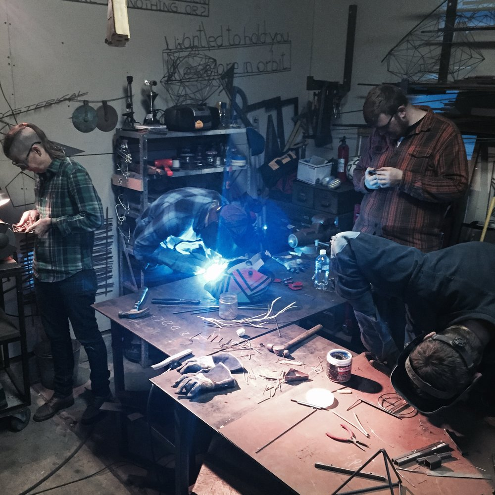 students working and welding.jpg