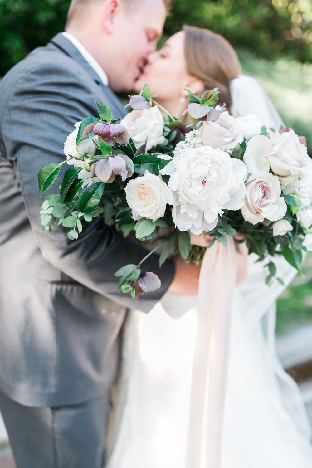 Bridal bouquet of hellebore, peonies, ranunculus and other spring florals.