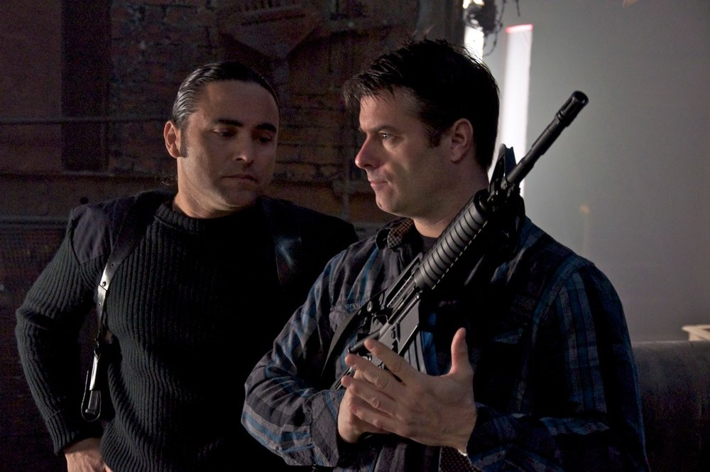 "Tapping into my prop knowledge going over this replica weapon with actor Louis De La Costa. ""Advent"" shoot spring 2011. Photo by Kevin J. Long."