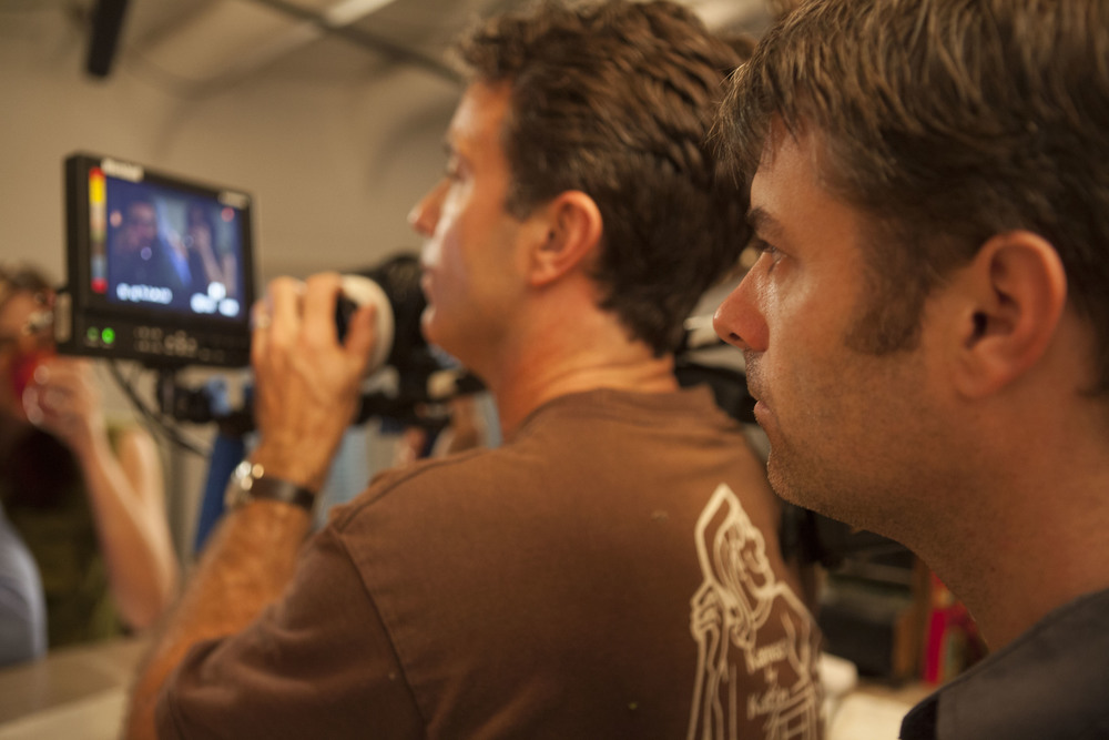 "Watching a take over DP Matt Mania's shoulder. ""Advent"" shoot spring 2011. Photo by Scott Everett White."