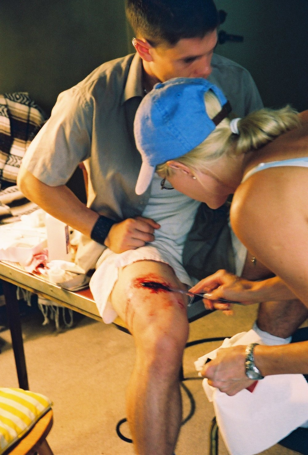 """Chance"" MU artist Jenny Dinkel applying movie blood to a SFX cut on ""The Thief."" Summer 2003.  Photo by Andy Conde."