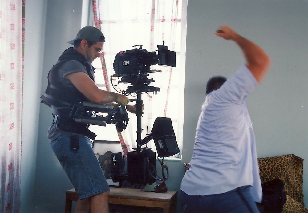 "Steadicam Richard Nez shooting actor Antoni Corone during a brutal scene from ""Elevator Music."" South Beach, Miami. Summer 1999.  Photo by Russell Valentine."