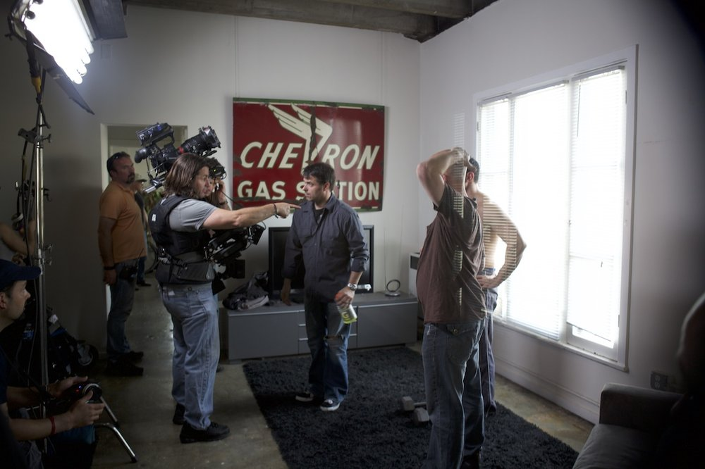 "Discussing the shot with steadicam op Rick Drapkin for a scene in an LA apt. ""Advent"" spring 2011. Photo by Scott Everrett White."