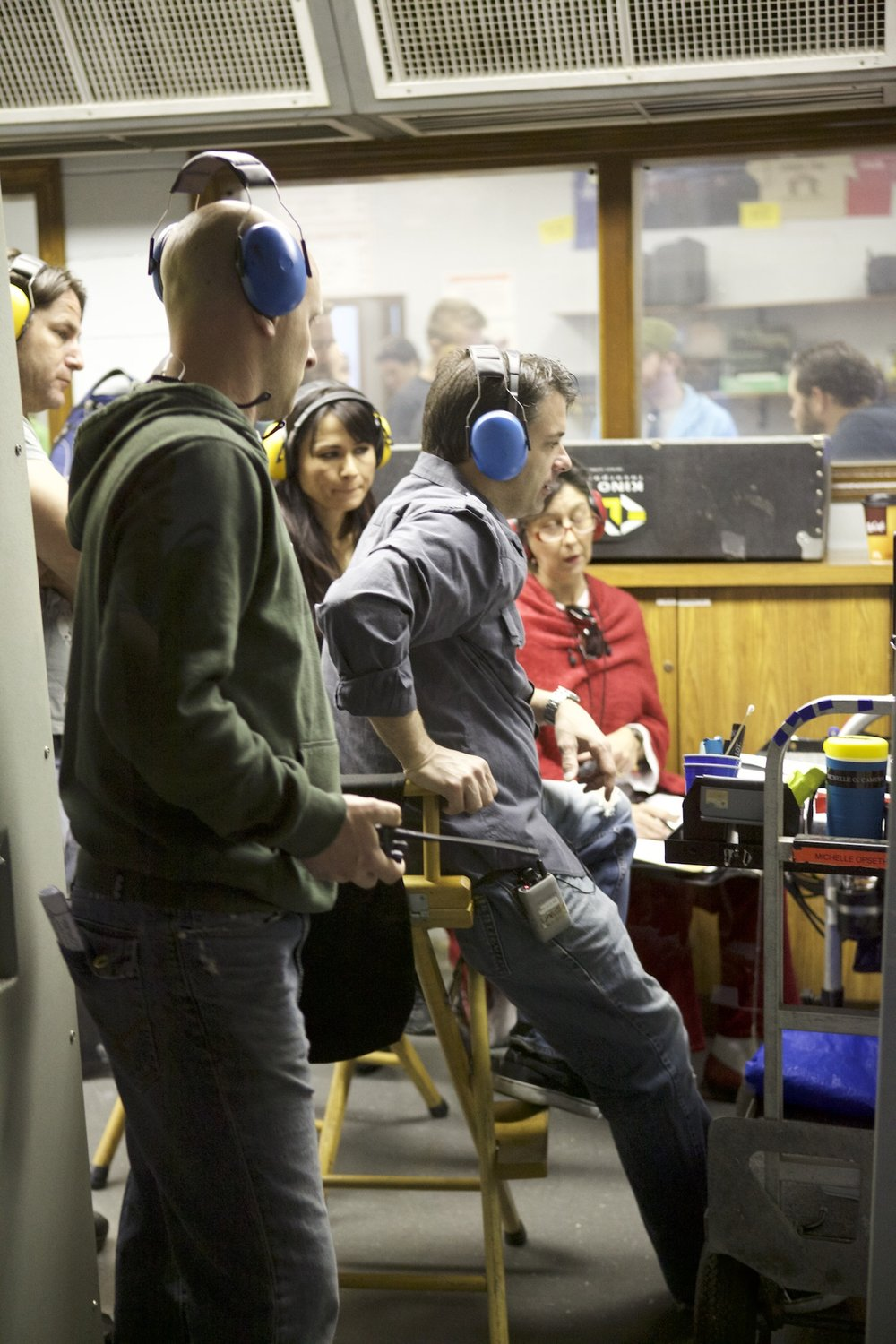 "Watching a take with producer Kimberly Estrada, scripty Allyson Young, and crew. ""Advent"" at the Firing Line gun range, Burbank, spring 2011. Photo by Scott Everett White."