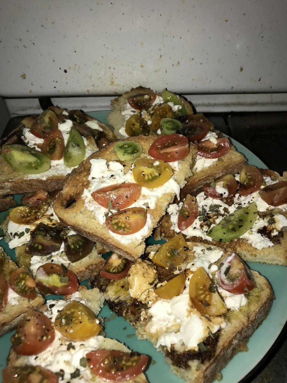 Bruschetta with burrata and heirloom tomatoes.