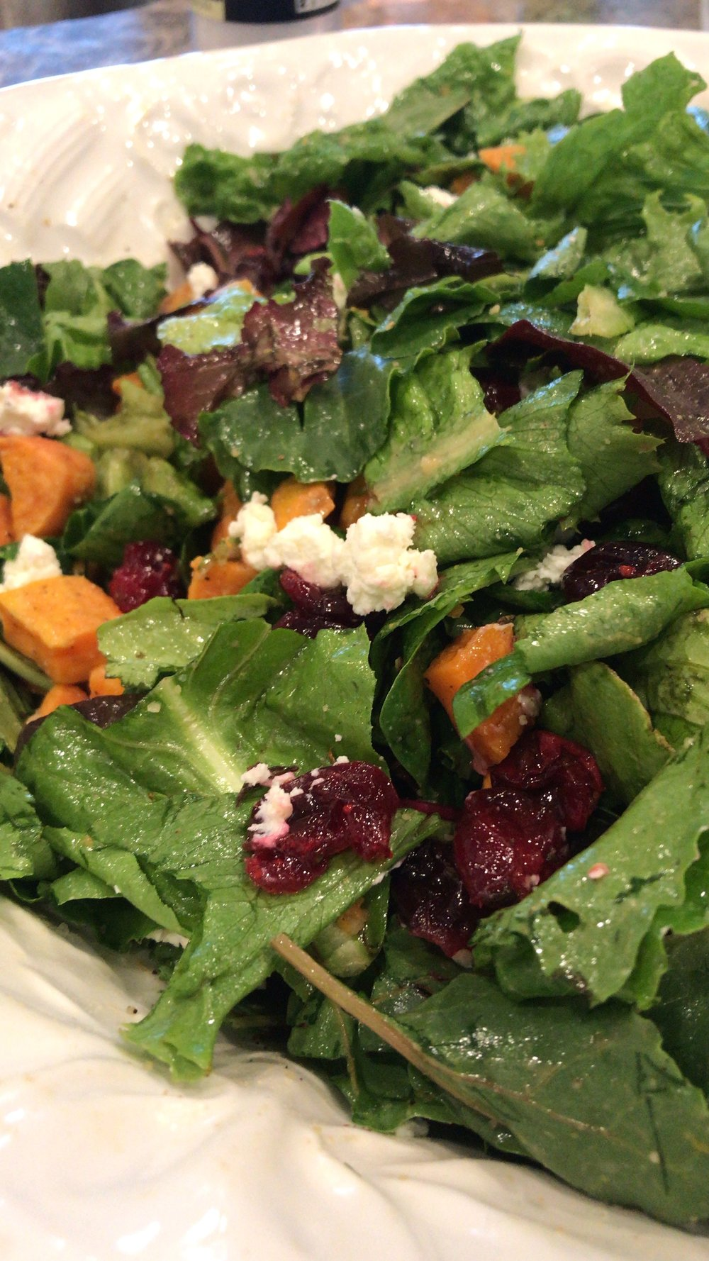 Harvest salad with roasted butternut squash, cranberries, and goat cheese.