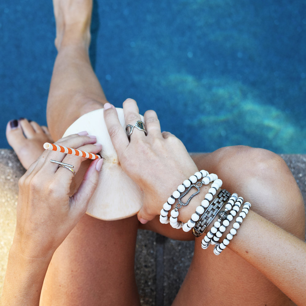 Wrap glamor around your wrist and fingers with these sterling silver, pave diamond, and white coral beads even in your swimsuit