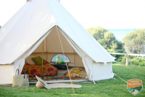 Beautiful bell tent village surrounding your tipi marquee reception.