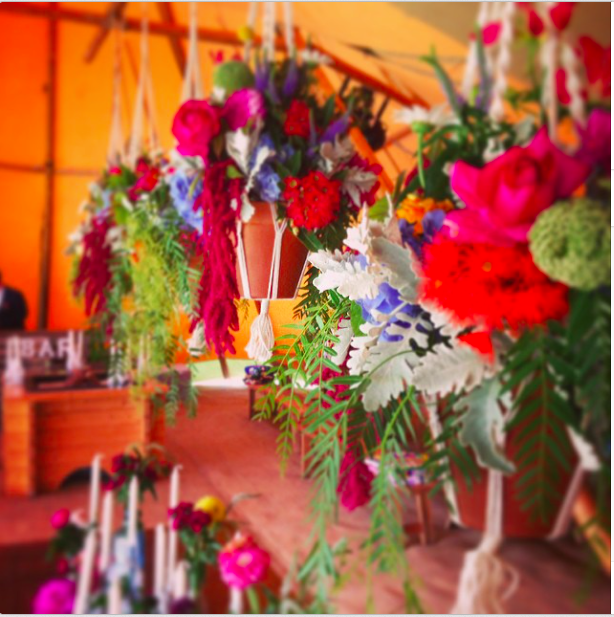 We always love a Tipi full of flowers.