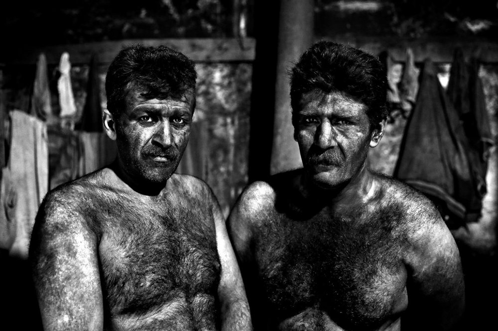 Iranian coal miners pose for a photograph before taking a shower after a long day of work at a mine near the city of Zirab 132 miles northeast of the capital Tehran on a mountain in Mazandaran province, Iran, May 7, 2014. (Photo: Ebrahim Noroozi/AP)