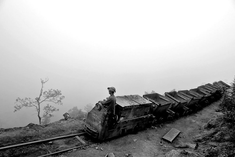 An Iranian coal miner moves wagons to be loaded with coal at a mine near the city of Zirab 132 miles northeast of the capital Tehran on a mountain in Mazandaran province, Iran on May 8, 2014. (Photo: Ebrahim Noroozi/AP)