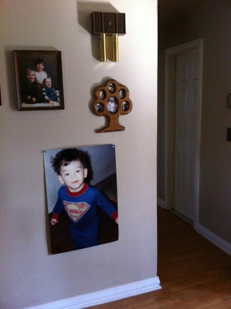 A picture of Tim in his superhero outfit, hanging in his mother's house. Photo courtesy Tim Manley.