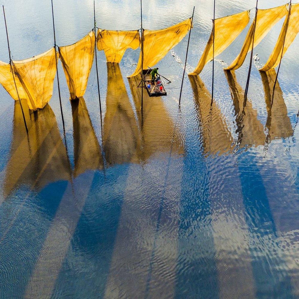 Catching the winning image ... fishermen close the net in Fujian province in China. This was the grand prize winner in the competition. Photograph: Ge Zheng/Ge Zheng/SkyPixel