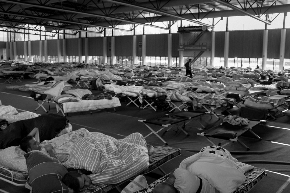 One thousand migrants and refugees from countries including Iraq, Syria, Pakistan, and Afghanistan, as well as regions of the Balkans and Africa at an emergency shelter at Olympia Stadiom in Berlin, Germany on September 24, 2015.