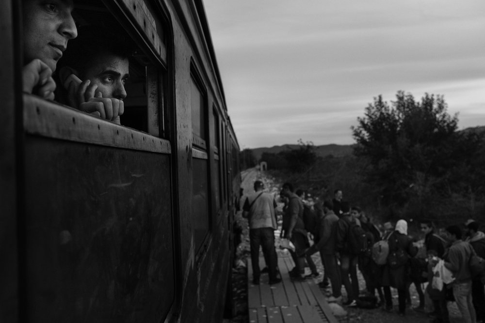 Refugees, primarily from Syria, Afghanistan and Iraq prepare to board a train at a refugee transit camp, or reception center for refugees and migrants, in Gevgelija, Macedonia on October 2, 2015.
