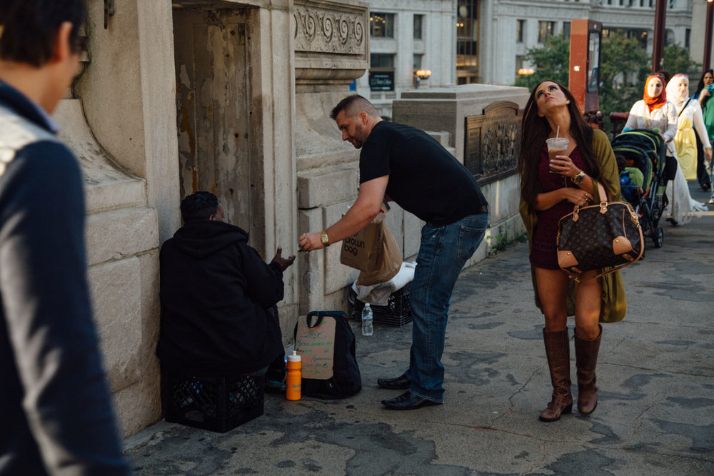 homeless woman man give money.jpg