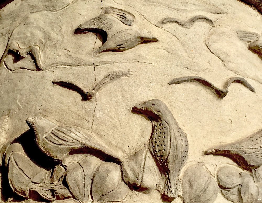Elmwood birds and other creek wildlife are depicted in the columns at Hampton Station.