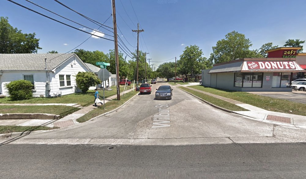 An Elmwood home on S Hampton Rd across the street from Oak Cliff Donuts.