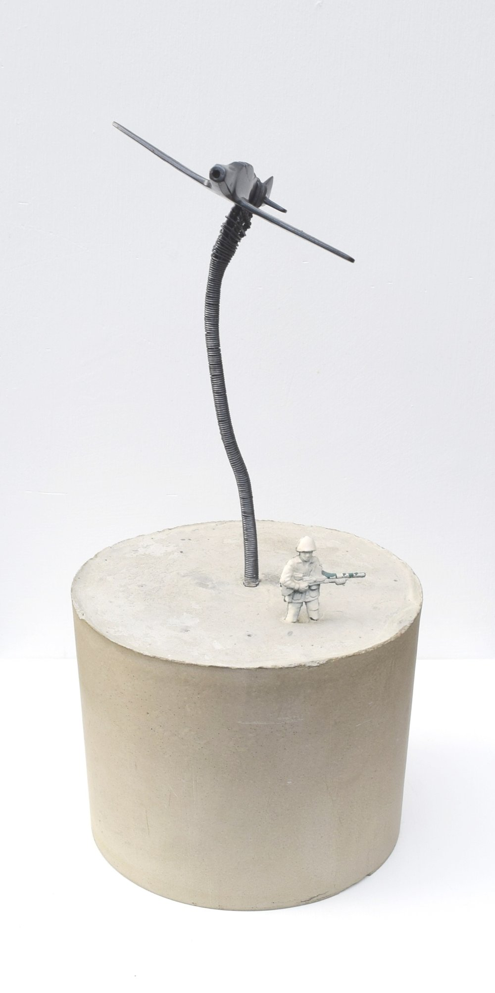 'NO HALF MEASURES' 2009    Concrete, plastic soldier, metal and spray paint 10 x 5 x 2 cm