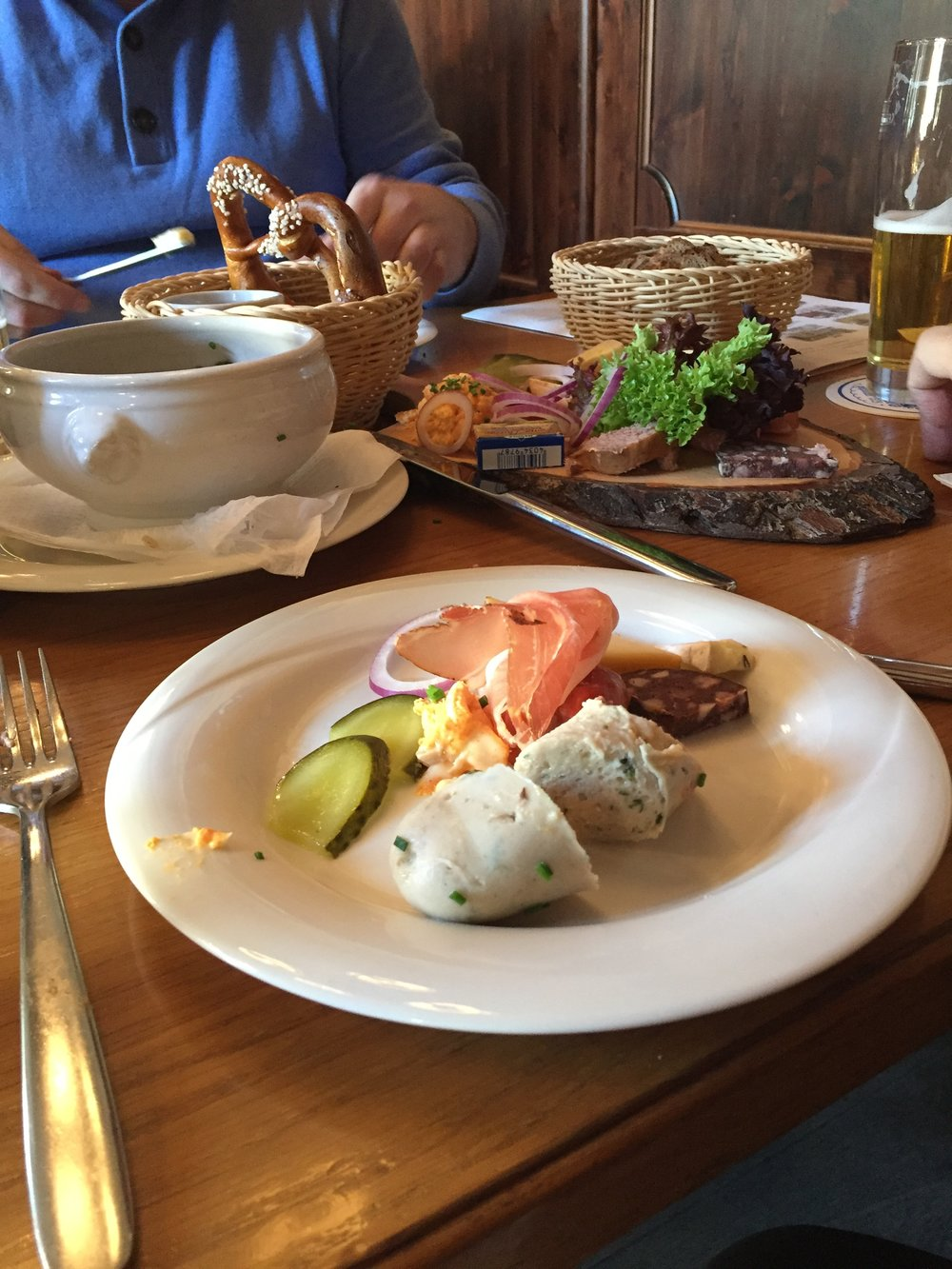 Our pub lunch of sausage, pickles, pretzels and beer