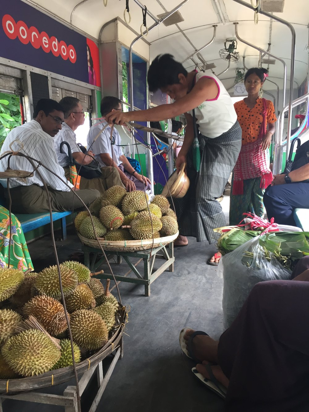 "Selling Durian on the train.  They are ripe and have a very strong smell - nicknamed the ""stinky fruit"""