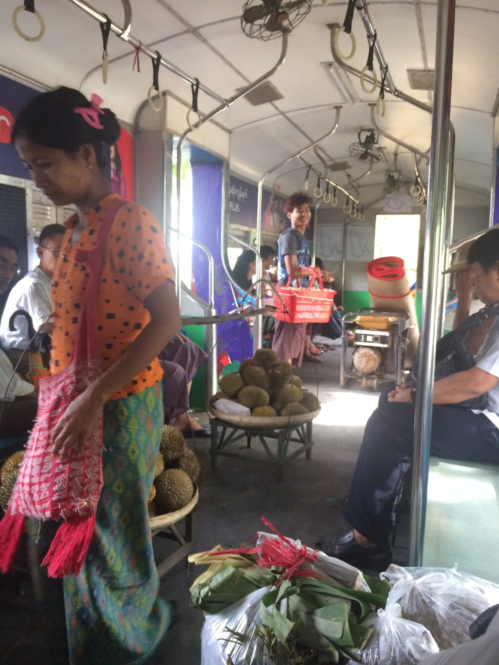 Vendor on train with face makeup