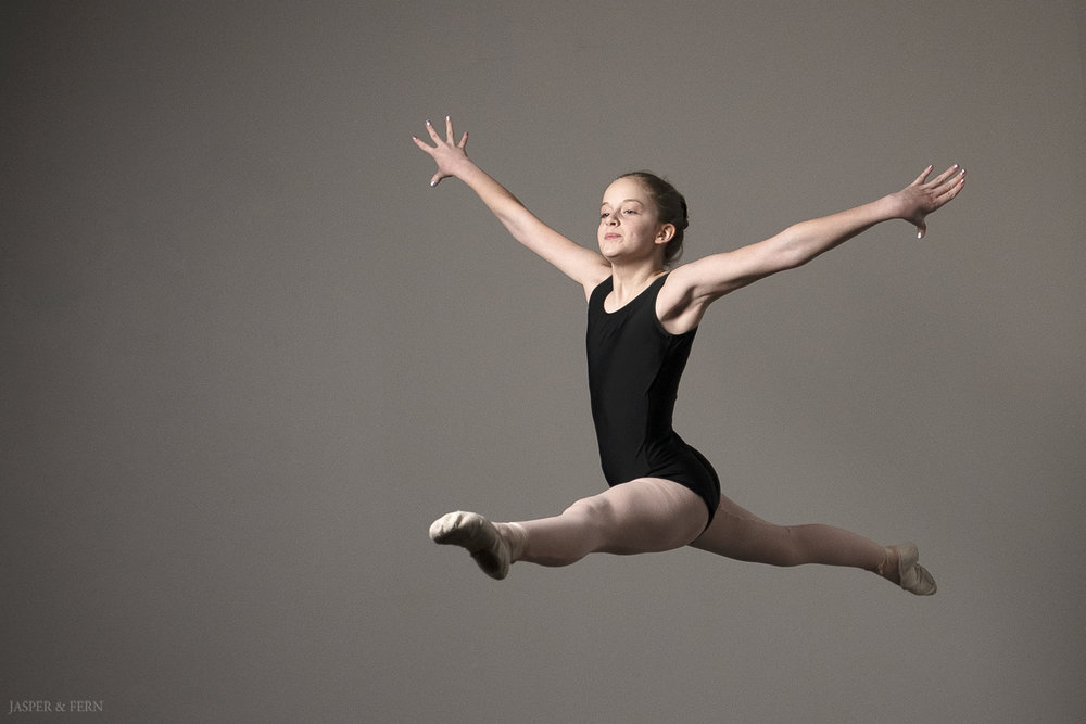 Dancer Portraits | Dance Photography | Black Leotard | Dancer bun hairstyle | dance routine | ballet leap | dramatic ballet portraits | dancer headshots | ballet shoes | dance shoes | Winston Salem Photographer | Jasper & Fern | ballerina | grande jete
