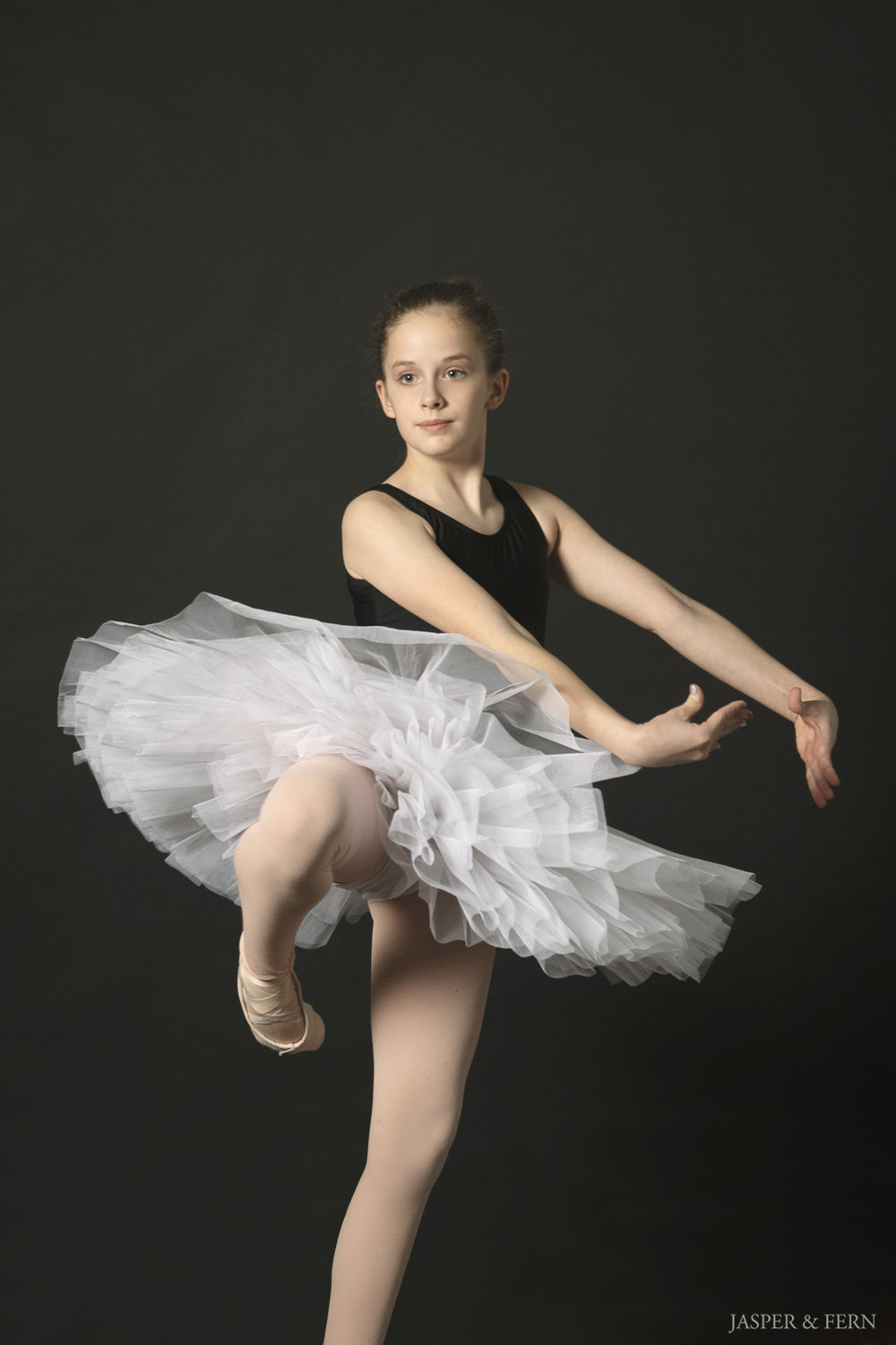 Dancer Portraits | Dance Photography | Black Leotard | Dancer bun hairstyle | dance routine | ballet leap | dramatic ballet portraits | dancer headshots | ballet shoes | dance shoes | Winston Salem Photographer | Jasper & Fern | ballerina | pirouette