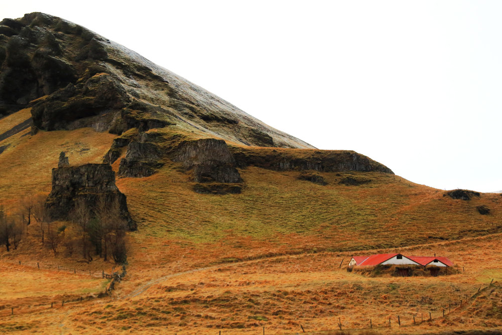 An earth-berm building on open farm land, Southern Iceland