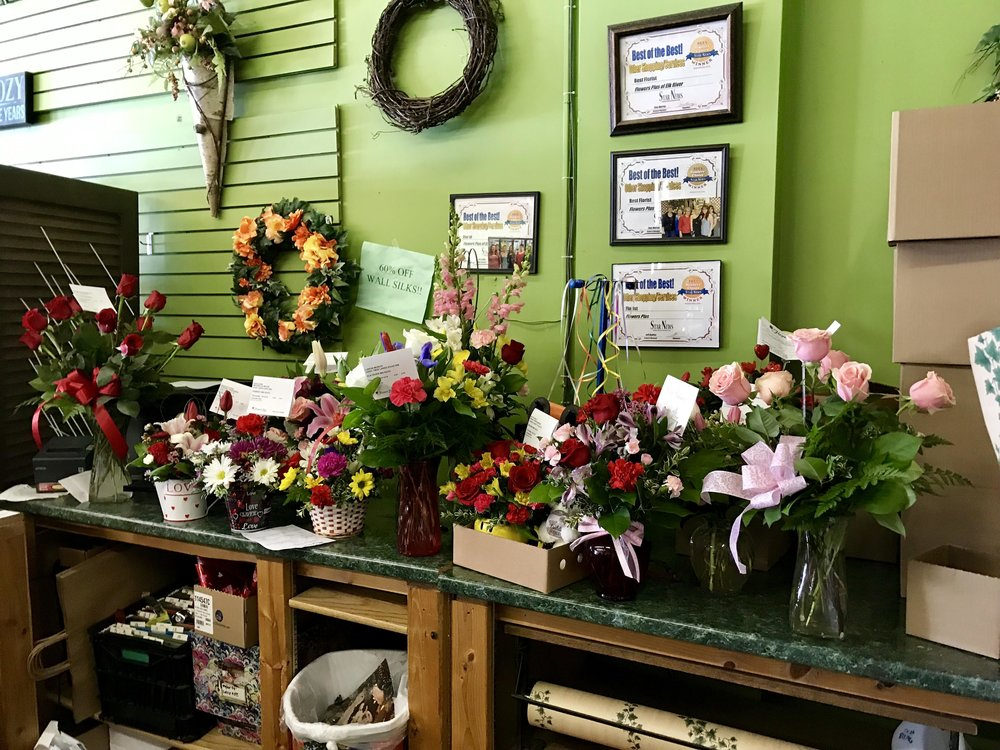 Bouquets waiting to be wrapped and delivered, Wednesday, February 13