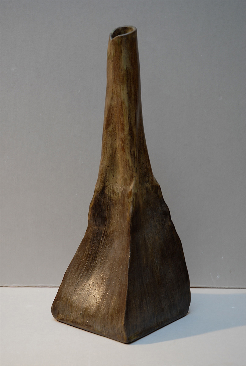 BROWN LONG NECKED VESSEL