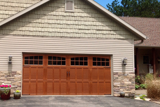 Carriage House The Carriage House Collection combines the beauty of a carriage-house door with the durability of steel.
