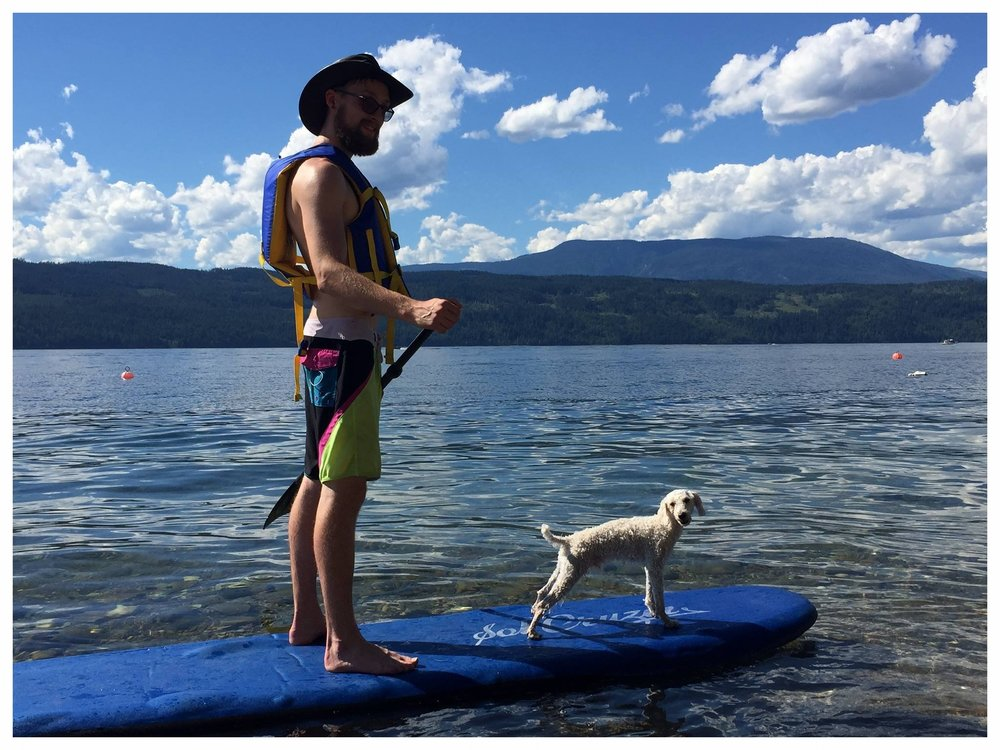 Gus with his owner Justin paddleboarding!