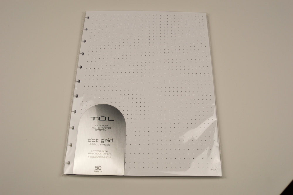 A package of refillable dot graph paper.
