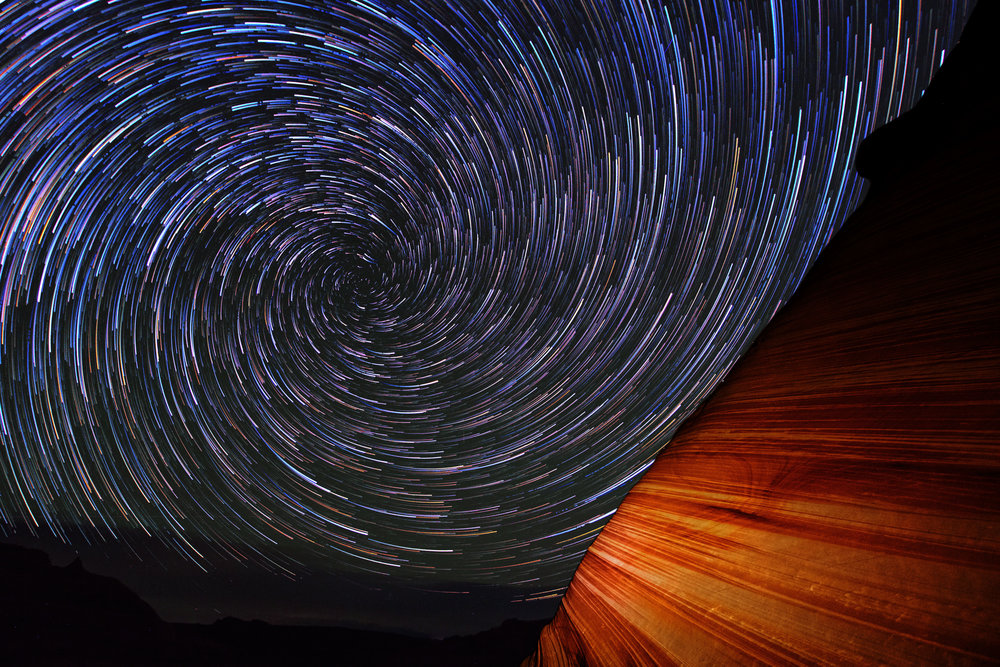 Watch the Stars Cascade Over Canyons in this Swirling Night Sky Timelapse