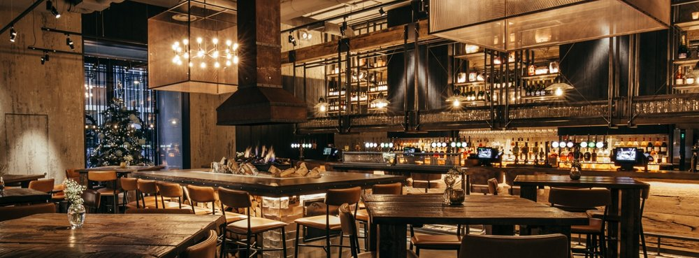Redefine dining at The Kitty Hawk: explore five bespoke culinary experiences under one roof, at the heart of the city.   The Kitty Hawk is infused with a heady blend of London cool and New York glamour. With polished concrete, exposed iron and tiled interiors, our five departments link together seamlessly to offer a truly unique experience.