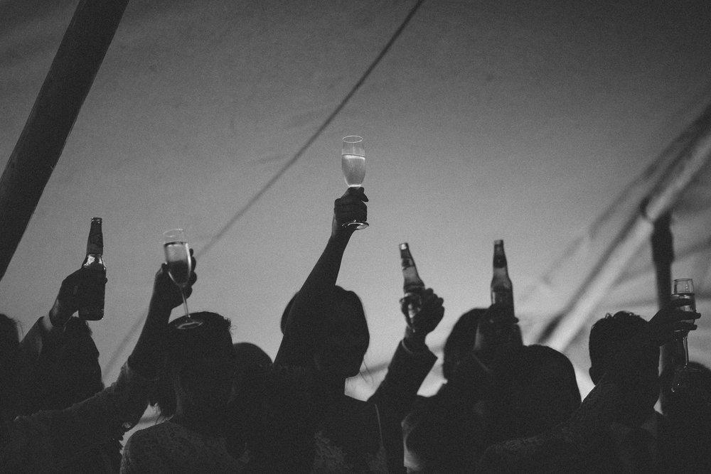 French-&-Fahey-Nordic-tent-festival-wedding-toast.jpg