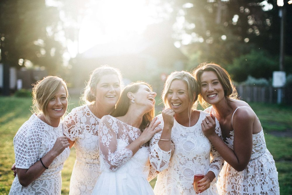 The Bride & her bridesmaids looking nothing short of amazing in white!