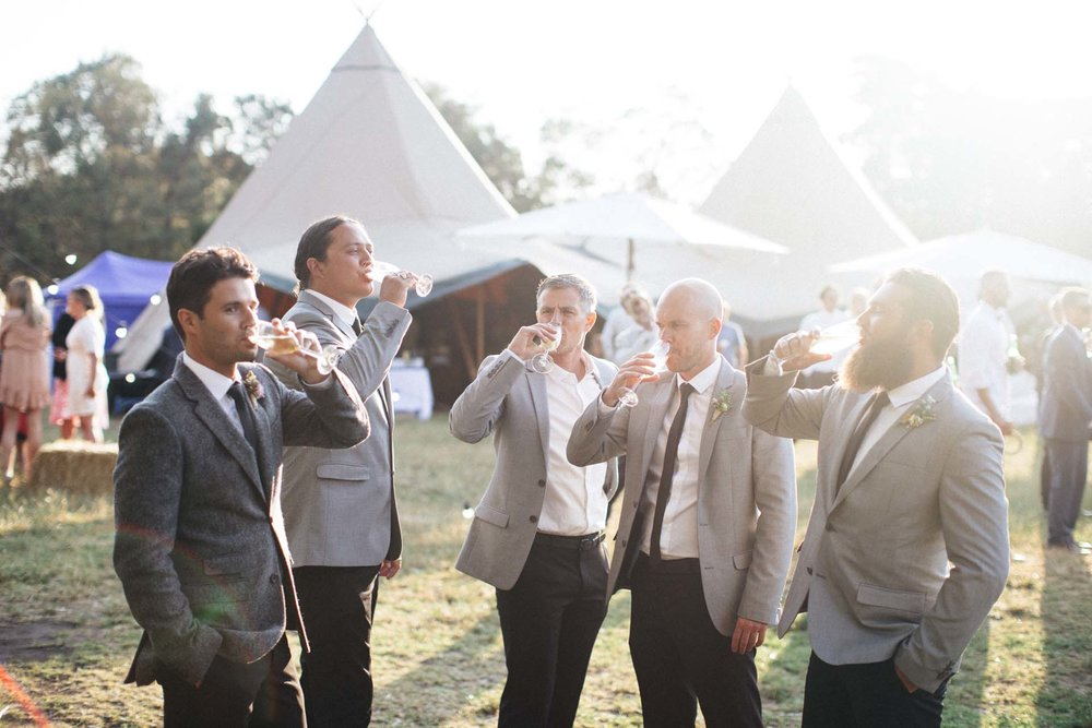 The grooms party enjoy a champagne toast outside the tent wedding venue!