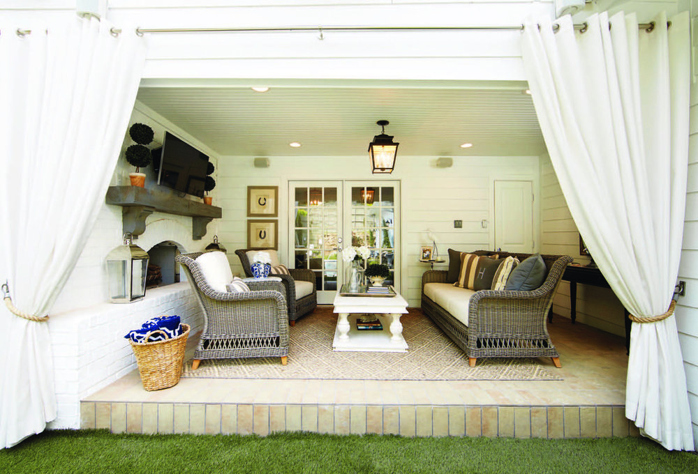 A wall was removed to transform this interior room into an indoor/outdoor cabana space that the family uses year round.