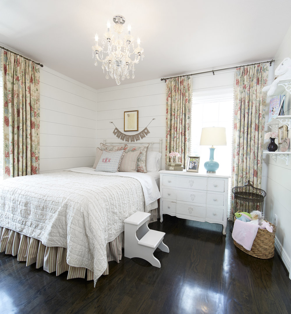 Each room in the house has a cohesive farmhouse feel, with slight variations to reflect the personalities of family member. With floral accents and a chic chandelier, daughter Stella's bedroom offers a shabby elegant spin farmhouse style.